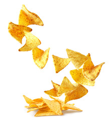 Flying delicious Mexican nachos chips on white background