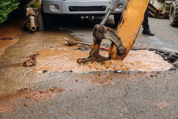 Splatter of water from broken pipe the main road