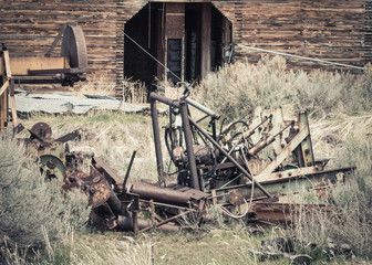 Old Machinery by an Abandoned Grain Elevator