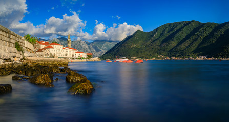 Scenic view of the postcard perfect historic town of Perast in the Bay of Kotor on a sunny day in the summer, Montenegro
