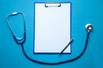 Stethoscope, medicine clipboard and pen. Doctor workplace