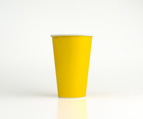 Yellow paper glass isolated on white background with clipping path