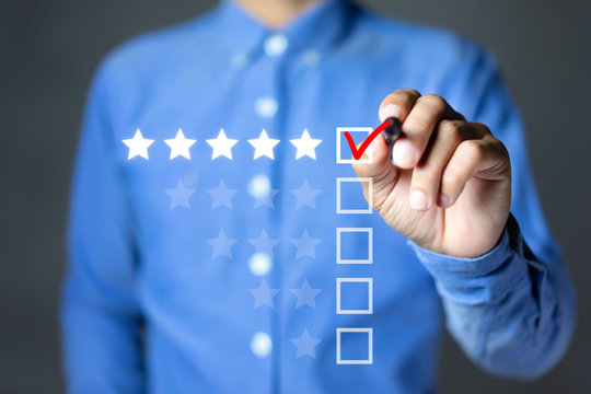 Businessman putting check mark a checkbox on five star rating. Increase rating company or ranking, evaluation and review concepts