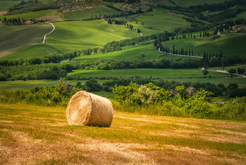 Tuscany landscape with hay bales in the field, Italy