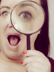 Adult woman with magnifying glss