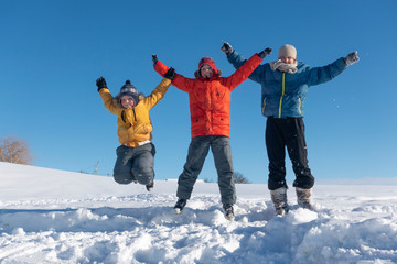 happy boys jump in winter outdoors