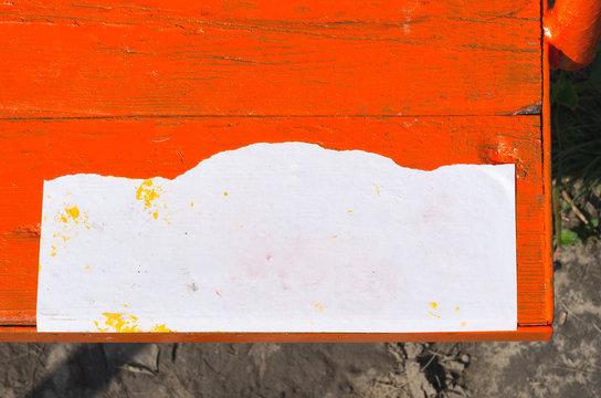Blank Paper Sign on Orange Timber Swing Seat Mock Up.