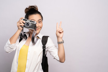 Happy woman take a photo by camera isolated over background