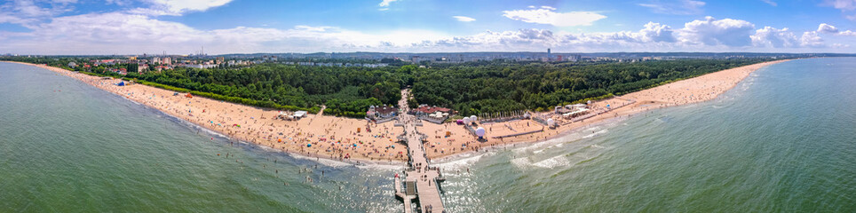 Summer beach panorama with wooden pier at Baltic Sea in Gdansk, Poland.