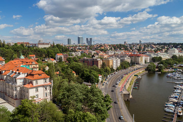 Small dock, boats and city next to the Vltava River in Prague, Czech Republic, viewed from the Vysehrad fort, on a sunny day in the summer.