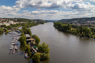 Small dock, boats and Vltava River in Prague, Czech Republic, viewed from the Vysehrad fort, on a sunny day in the summer.