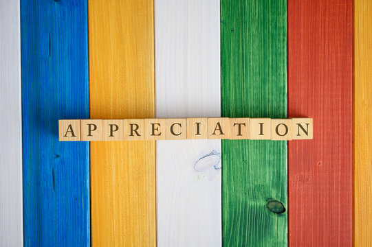 Top view of the word Appreciation spelled on wooden cubes