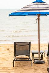 Umbrella and chair around beach sea with blue sky