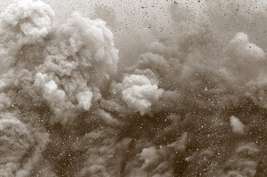 Rock particle and dust clouds after detonator blast