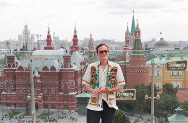 """Film director Tarantino poses for a picture during a photocall for """"Once Upon a Time in Hollywood"""" in Moscow"""