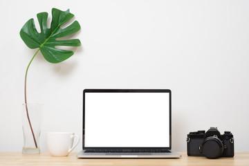 Wall Mural - Laptop computer blank screen on wood desk. Minimal style desk.