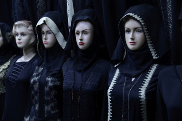 Mannequins stand outside the traditional Islamic shop in the holy city of Kerbala
