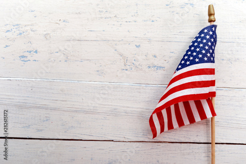 United States of America flag hanging on a rustic wooden background with copy space