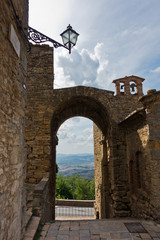 One of the gates at Voltera city walls with a view on surrounding landscapes, Tuscany, Italy
