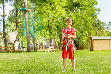 Portrait of a boy with rope climb equipment park