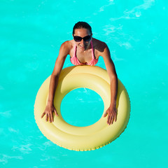 Woman swim on inflatable buoy view from above