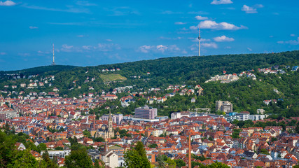Germany, Cityscape of stuttgart city skyline from above in valley and television tower on forested mountain Wall mural