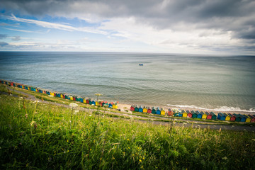 Beautiful view on the sea and beach huts in Whitby, Emgland
