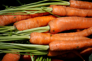 Carrots are seen for sale on a fruit and vegetable stall at Alsager market, Stoke-on-Trent
