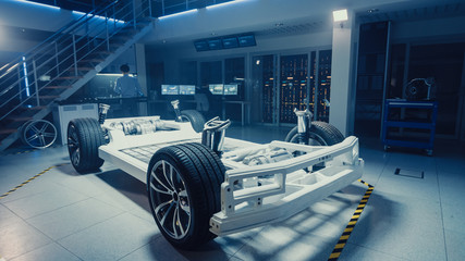 Concept of Authentic Electric Car Platform Chassis Prototype Standing in High Tech Industrial...