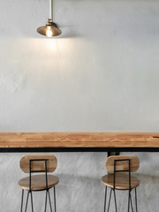 Empty on people. Coffee shop interior design With chairs, vintage light bulb and white walls.