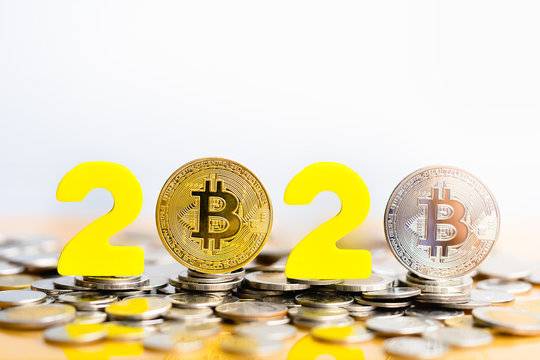 Bitcoin  2020. Bitcoins are next to the numbers 2. Prediction of Price bitcoin in year 2020. Future Bitcoin Value for 2020, 2022, 2030.