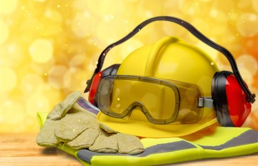 Safety helmet with earphones and goggles on construction background Wall mural