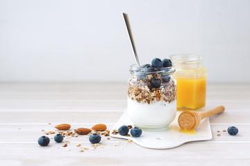 Healthy breakfast in glass jar with yogurt, muesli and blueberries. Healthy food.