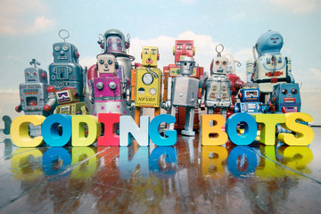 Wall Mural - a team of vintage robots on a old wooden floor  with the word CODING BOTS