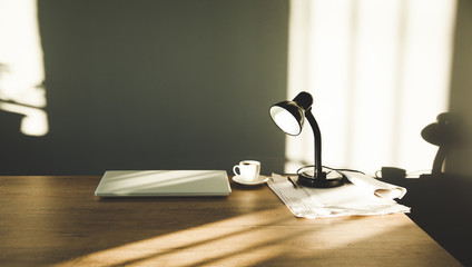 lamp with computer and coffee