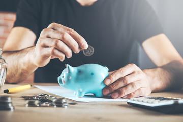 man hand piggy bank with coins