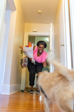 Woman returns home with bouquet of flowers
