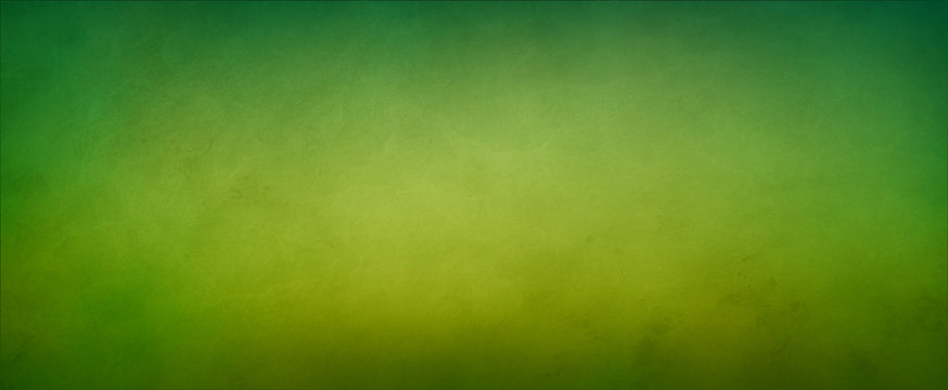 Abstract yellow green background with soft bright gold center glowing with light colors and dark blue green border with blurred mottled texture