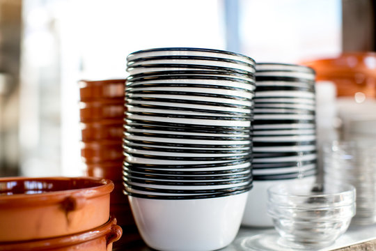 stack of enamel bowls