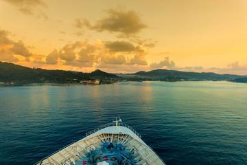 POV shot of the bow of a cruise ship as it comes into port in Coxen Hole, Roatan, Honduras.