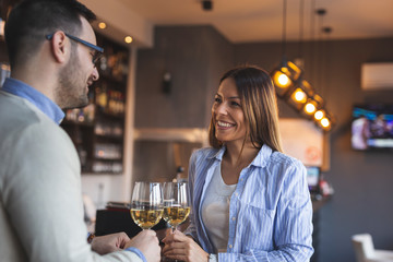 Couple in a restaurant drinking wine
