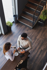 Couple in a coffee shop drinking coffee