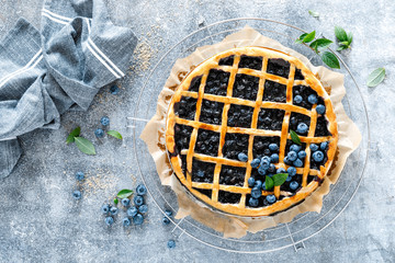 Traditional homemade american blueberry pie with lattice pastry, top view.