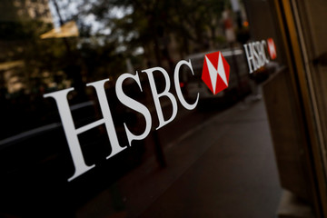 HSBC logos are seen on a branch bank in the financial district in New York
