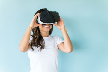 Happy Female Wearing Virtual Reality Headset Over Isolated Background