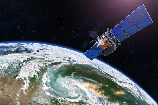 Satellite above the Earth measurements. Sensing, research, probing, monitoring of foci forest fires marked by outbreaks, smoke spreads over large areas. Elements of this image furnished by NASA.