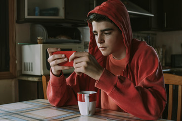 young man with phone and cup of coffee