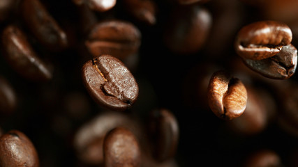 Coffee beans flying in the air, macro photo