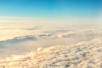 Beautiful scenic dramatic morning sunrise cloudscape aerial view from plane window. Gradient...