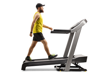 Bearded guy in sportswear walking on a treadmill with an incline